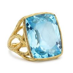 Elizabeth Showers: Tree of Life Ring with Blue Topaz.