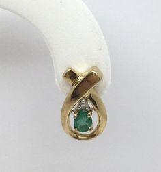 10K yellow gold freeform, swirl oval Emerald & Diamond stud earrings