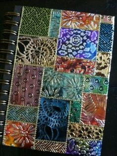 Art journal inspiration: This beautiful journal was made by Els using Shimmer Sheetz which have been run thru embossing folders and rubbed with alcohol ink.