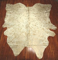 Acid washed white and gold cow skin rug. We bought one. Now just trying to figure out where to place it...