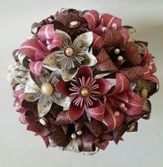 Origami bouquet i love this wedding idea pinterest vintage wedding theme paper origami flowers bouquet alternative flowers with vintage buttons and pearl trims www mightylinksfo