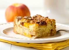 A recipe for Peach Coffee Cake - light, moist and infused with a cinnamon-sugar & pecan streusel.