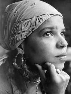 If you read any of her poems, & yet you do not understand why I continually return to them , I couldn't explain, & I'd be inclined to dismiss you as a person. People of Watts: http://www.math.buffalo.edu/~sww/poetry/shange_ntozake.html#people%20of%20watts  Blood Rhythms - Blood Currents - Black N' Blue Stylin': http://www.math.buffalo.edu/~sww/poetry/shange_ntozake.html#Blood%20Rhythms  (& if you think you need to be black or something to get it, I'd be inclined to dismiss you as a person).