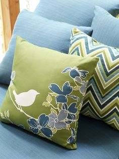 Pretty up your patio by layering outdoor pillows in varying patterns within the same color family.