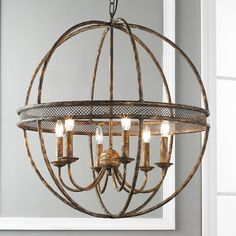 Lattice Banded Sphere Chandelier Aged golden lattice adds the regal touch to this open metal sphere with 6 light chandelier inside. 6x40 watts candle sockets.