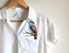 Blue orange bird  woman handpainted shirt pocket by Dariacreative, $45.00