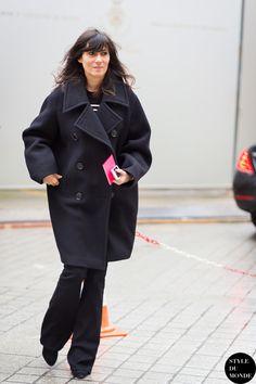 Emmanuelle Alt in a black coat + striped sweater + black flared jeans + black ankle boots