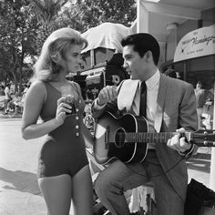 Ann-Margret and Elvis Presley on Set of Viva Las Vegas-1964 i loved this movie growing up..mostly cause i liked the scenes of Ann she dances crazy! lol