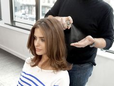 """With your blowdrying complete and curls unpinned, spritz your hands with a light shine spray and rake your fingers through hair while pushing it upward to build bounce. """"People get into trouble with sprays because they hold them too close to their scalps,"""" advises Townsend. """"The product ends up in globs in some areas and completely missing from others. You get better results if you just use your fingers."""""""