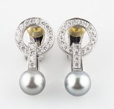 Very-Rare-Vintage-Cartier-18k-White-Gold-Diamond-Pearl-Agrafe-Drop-Earrings. 1.12.5 of an inch long. £ 6, 250.