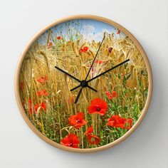 Poppy in a wheatfield Wall Clock