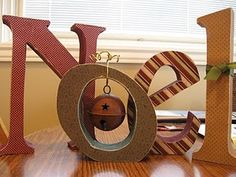 Noel...love the dangling jingle bell.  ooh i know someone who could make these !