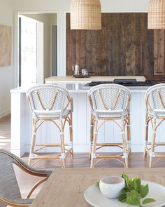 Handmade rattan bistro chairs add a chic touch to this gorgeously rustic kitchen. With their woven plastic seats, they allow for a bit of color play while keeping the space family-friendly. Dining Room Furniture, Dining Chairs, Ikea Chairs, Dining Rooms, Dining Decor, Bar Chairs, Dining Area, Furniture Ideas, French Bistro Chairs