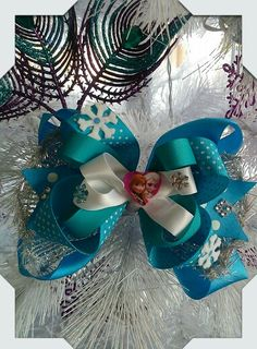 Frozen theme bow made by Norma's Unique Gift Baskets. $6.99