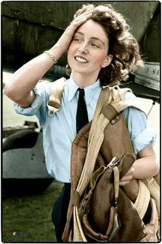 Maureen Dunlop (aged 24), an Air Transport Auxiliary (ATA) pilot, in front of a Fairey Barracuda, September 1944.