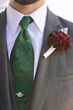 Jewel toned tie and boutonniere: http://www.stylemepretty.com/illinois-weddings/st-charles-illinois/2015/12/21/traditional-royal-fox-country-club-fall-wedding/ | Photography: Katharine Salvatori - http://katherinesalvatori.com/