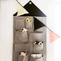 ferm LIVING Kids House Wall Storage: https://www.fermliving.com/webshop/shop/kids-room/kids-wall-decoration/house-wall-storage-grey.aspx