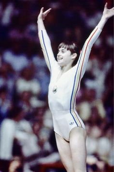 At 14 Nadia Comancei stunned judges when she landed a perfect score at the 1976 Olympics. Gymnastics History, Sport Gymnastics, Olympic Gymnastics, Olympic Games, 1976 Olympics, Summer Olympics, Nadia Comaneci 1976, Montreal, Life In Usa