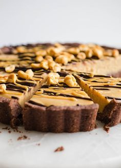 Vegan Peanut Butter Pie made with all-natural peanut butter, coconut milk, and maple syrup in a chocolate almond flour crust. A gluten-free frozen dessert recipe made healthy.