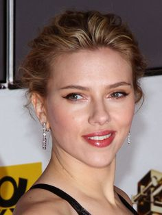 Look younger with a looser updo ala Scarlett Johnansson!