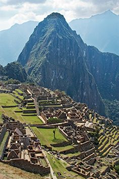 Machu Picchu with Huayna Picchu  mountain in the background This world is really awesome. The woman who make our chocolate think you're awesome, too. Please consider ordering some Peruvian Chocolate http://www.amazon.com/gp/product/B00725K254