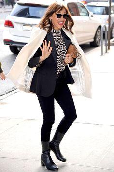 Rashida Jones looks chic-as-can-be in her dapper ensemble and cat-eye inspired shades.