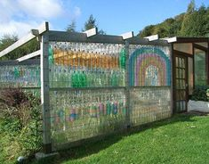 """Community artist Ilona Bryan says she has """"done a lot of strange things with recycling plastic drinks bottles"""" over the years, although she apparently never thought of building walls. She snapped this photo of a natural sewage treatment area for Scotland's Earthship Fife.  The facility also has a greenhouse made in the same way, as well as various renewable energy and alternative building demonstration projects.   - GoodHousekeeping.com"""