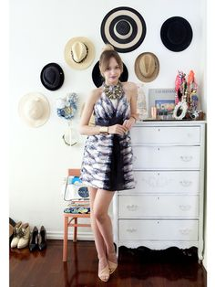 Fashion blogger Liz Cherkasova fits right into her fashionable home with a Tibi Dress, Zara shoes, Ruche necklaces, and ASOS cuffs.