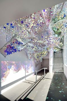 """Capturing Resonance"" by Soo Sunny & Spencer Topel~Chainlink & iridescent acrylic installation"