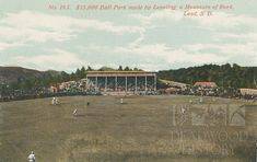 """A baseball game is in progress on Lead's Mountain Top Field in this W.B. Perkins postcard from the early 1900s. Flat ballfields can be hard to come by in the Black Hills, and this postcard claims it was necessary to """"level a mountain of rock"""" to make this diamond. John B. Mayo Postcard Collection. Adams Museum Collection."""