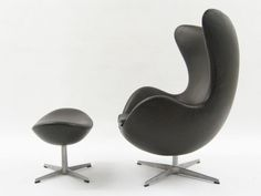 Arne jacobsen style egg chair complete with ottoman.