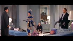 "Love this royal blue fur-trimmed ensemble worn by Rosalind Russel in ""Auntie Mame""."