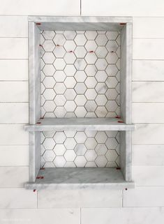 Gorgeous marble shower niche! Love the hexagon tile on the back of it! #tile #showertile #BathroomTray Tile Shower Niche, Shower Floor Tile, Master Shower Tile, Bathroom Lighting Design, Bathroom Light Fixtures, Marble Showers, Bathroom Showers, Chic Bathrooms, Tiled Bathrooms
