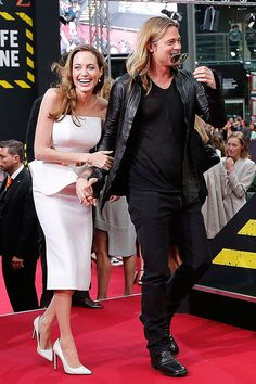 Angelina Jolie and Brad Pitt World War Z Berlin premiere I would like to know what they said to each other to make them laugh so hard!