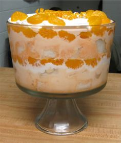 Time Travel Kitchen: Dreamsicle Trifle 2 large cans mandarin oranges 1 small pkg. orange gelatin powder 1 pint orange sherbet 1 cup whipping cream, whipped (no sugar or vanilla, just whipped. Trifle Desserts, Pudding Desserts, Delicious Desserts, Yummy Food, Trifle Dish, Angel Food Cake Trifle, Fruit Trifle, Sweet Recipes, Cake Recipes