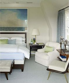 Serene Blue And Cream Bedroom With Seascape Photo by Steven Gambrel