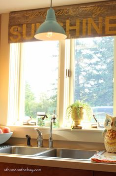 Ikea Hack Barn Light Love the light and the wood valance. Instructions to make barn light. Kitchen Window Valances, Kitchen Sink Window, Kitchen Decor, Kitchen Ideas, Diy Kitchen, Kitchen Blinds, Gold Kitchen, Kitchen Wood, Window Curtains