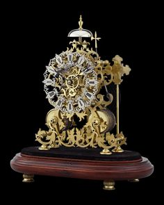 English Skeleton Clock by J. Smith & Sons of Clerkenwell~ This exceptional two-train English skeleton clock was crafted by the celebrated clockmakers J. Smith & Sons of Clerkenwell. The beautifully designed floral scroll frame incorporates an ivy motif, which perfectly complements the Gothic-style pierced and engraved oversized dial. The timepiece is powered by an 8-day movement and strikes the hour and half hour on the bell that surmounts the elaborate frame. ~M.S. Rau Antique Clocks, Rare Antique, Skeleton Clock, Clocks For Sale, Custom Glass, Glass Domes, Quality Time, Gothic Fashion, Ivy
