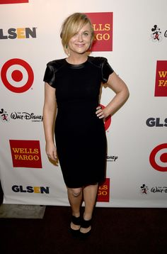 Amy Poehler looking chic in a THEIA crepe cocktail dress with leather cap sleeves at the 10th Annual GLSEN Respect Awards -