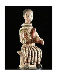 Mami+Wata+:+son+nom+est+une+adaptation+de+l'anglais+mommy+water+:+c'est+la+déesse-mère+des+eaux,+figure+mythique+et+très+populaire+du+culte+Vaudou+(religion+officielle+au+Bénin). Crainte+des+pêcheurs,+cette+déesse+symbolise+aussi+bien+la+mer+nourricière+que+l'océan+destructeur. Mami+Wata+est+avant+tout+une+divinité+éwé,+dont+le+culte+est+très+présent+sur+la+côte+atlantique+du+Togo+(mais+aussi+au+Nigeria,+au+Cameroun,+au+Congo)+où+elle+symbolise+la+puissance+suprême.