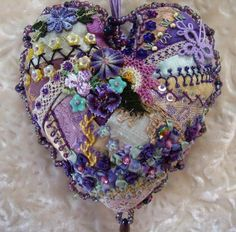 A crazy quilt heart pincushion.