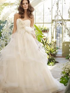 stunning tulle bridal ball gown with flower appliques on bodice and strapless sweetheart neckline