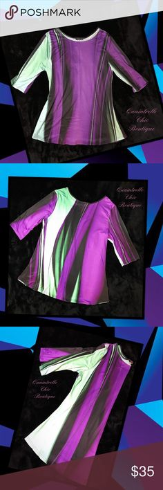 """🆕JUNIPER BREEZE PURPLE AND TEAL TUNIC Kick your look up a notch with this bold tunic boasting a comfortable stretch-infused blend and three-quarter sleeves for just the right amount of coverage. 92% Polyester 8% Spandex 💜🖤💜🖤💜🖤💜🖤💜🖤💜🖤💜🖤💜 Bust 24"""" Length 34""""  ✔️ Bundle and save Quaintrelle Chic Boutique Tops Tunics"""
