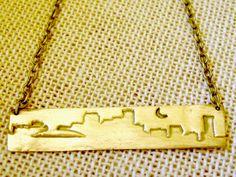 new orleans skyline bronze necklace. $36.00, via Etsy.