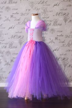 Repunzel- when I make it make pink layer short and purple long. Top sweetheart with tulle layer corseted