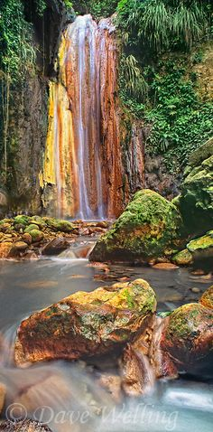 Castries, St. Lucia. Journey to the historic Diamond Estate to explore its botanical gardens and discover the colorful mineral-stained rock face of Diamond Falls.
