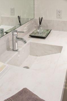 Corian® Rain Cloud custom sink and vanity.                                                                                                                                                      More