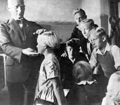 A German teacher lauds his students for their Aryan & Nordic features