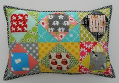 paper pieced pillow, via Flickr.