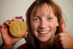 American Katie Ledecky, 15, poses with her gold medal in the 800-meter freestyle, in which she is the American record holder.